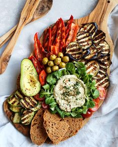 colorful mediterranean antipasto platter with lots of grilled vegetables, homemade olive sun dried tomato bread and hummus. We are going on…