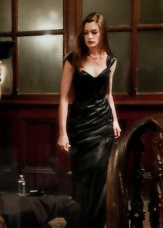 Anne Hathaway as Selina Kyle-God, I love her in this role!---The Dark Knight Rises