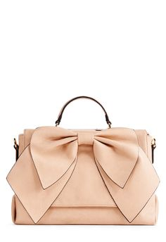 Here's a bag that's undeniably bow-tiful! Flirty and feminine, Bisou by JustFab has a fresh front bow that is luxe for the evening.