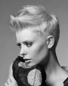 Short spiky pixie haircut. I have mine pretty much the same as this cut and I can't begin to explain to you how awesome it is. The truth definitely set me free.