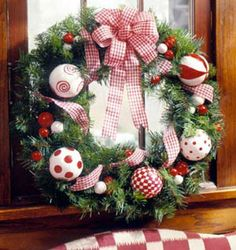 Love the choice of ribbon and ornaments on this wreath