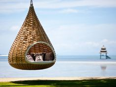 In this hanging cocoon hammock in the Philippines. | 30 Places You'd Rather Be Sitting Right Now
