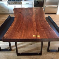 Dining room table collaboration with @noedesignco. Black walnut with brass bowties.