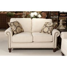 Telisa Living Room Loveseat   Upscale fashion, trendsetting fabrics, clean tailored lines, and moderate scale combine to make a stunning focal point to your living room!    #bernieandphyls #loveseat