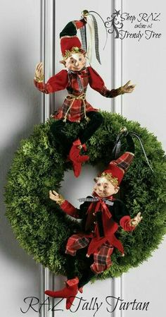 Christmas Elves in red and black on green wreath