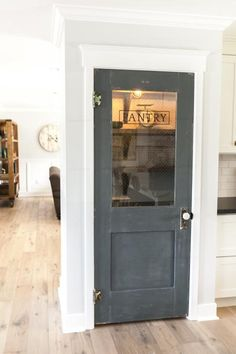 The team from Rafterhouse made over an Arizona ranch house. They added an antique-looking door in the open-concept kitchen and dining room. Kitchen Pantry Doors, Glass Pantry Door, Pantry Closet, Kitchen Rack, Kitchen Island, Kitchen Cabinets, Door Design, House Design, Vintage Pantry