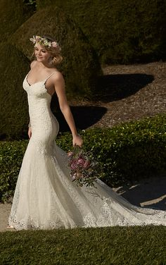 Essense of Australia wedding dress  #D1934 -WG- Fit and flare lace gown with a sweetheart neckline and spaghetti straps that form into a low back. Lace buttons continue the train of the gown.