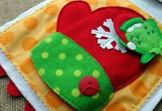 LITTLE CHRISTMAS #quiet book pattern featuring little animals which hide in Christmas items. This little froggy has been hiding in the winter mitten. Lindy J Design at ETSY.