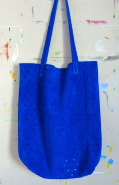 A bright cobalt suede tote can boost anyone's spirits!