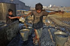 CAN YOU SEE ME? Nawab (age 12) and his friend Jabar make glue by boiling scraps of leather that they scavenged from debris, in Dhaka District of Bangladesh. The work – which exposes them to a myriad of toxic chemicals – earns each boy about 60 taka (approximately US 0.88) for each 13-hour shift. They are among nearly 215 million children involved in labour worldwide, of whom nearly 115 million work in hazardous conditions. © UNICEF/Shehzad Noorani  - To see more: www.unicef.org/photography