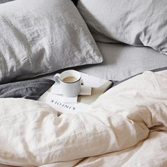 Cozy bed with morning coffee and read