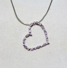 Stunning Sterling Silver necklace with pink ice heart pendant IA10 (I have a large pendant that hangs like this - all pink stones - very pretty! kj )