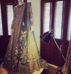 White anarkali with golden lehenga and blue dupatta | elan on instagram | great for nikah or walima | Pakistani wedding fashion