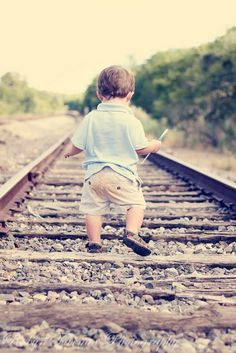 Little boy on the train tracks.  Noah's 2 year pics
