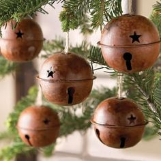 Primitive Bells, by them at your local craft store, add twine and wah lah!  A perfect ornament gift for someone special.