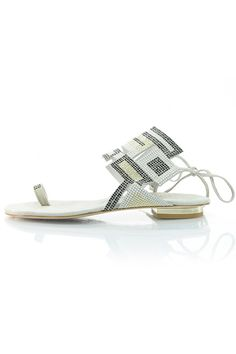 The geometric patterns on this Luis Onofre sandal will set you apart from the pack. Black, white and gold details bring some color to this grey suede gladiator sandal. A toe strap and lace up back will keep the complements coming when you rock this sandal. Suede Gladiator Sandal by Luis Onofre. Shoes - Sandals - Flat South Carolina