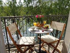 Brealfast on the balcony at Quai d'Orleans, overlooking the Seine!