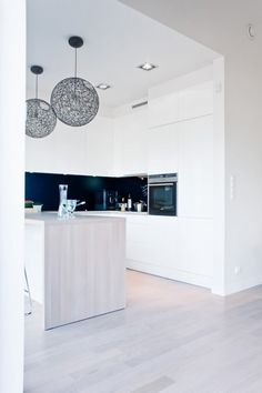 Wonderful Minimalist Black-And-White House With Oak Floors And Furniture : Wonderful Minimalist Black And White House With Oak Floors And Furniture With White Wall Oven Kitchen Island Table Bar Stool Chair Chandelier And Sink With Hardwood Floor