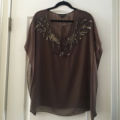 Olive green sheer blouse. This is a beautiful olive green blouse. The sequence and beading gives it the perfect touch. Comes from a pet free/smoke free home. Forever 21 Tops Blouses