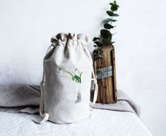 This is a storage pouch bag with hand embroidered snowdrops. Embroidered Bag, Pouch Bag, Natural Linen, Decoration, Hand Embroidery, Bucket Bag, Storage, Fabric, Cotton