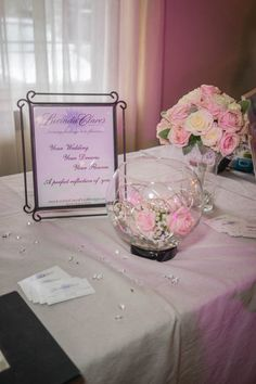 Pink and White rose bouquet and bubble bowl centerpiece on my table at the Beauty and Bridal 2014 Photo By Danielle Nichole Fine Art Wedding & Lifestyle Portraiture