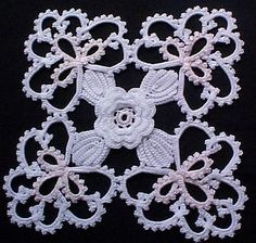 This looks a lot more like tatting than it does crochet. I think I'll try to make a pattern. :)