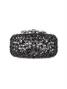 CROWN GOA, A signature of our handbag collection, the Embroidered Goa is beloved among the fashion set for its sophisticated finish and luxe hand. Add a pop of subtle sparkle to your gala style with this embellished collector's clutch bursting with black jet crystal and hematite stones on one side. The evening clutch is then crowned with a genuine Swarovski crystal clasp for the perfect finishing touch.
