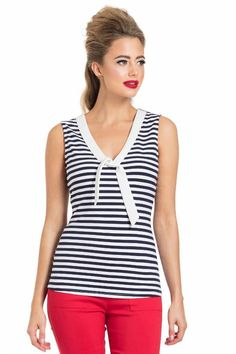 Ahoy matey! Join us on a sea cruise in this sleeveless striped nautical top. It's navy and white striped with a white tie in the front. Our model Julie Ann's me