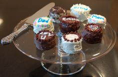 """The cakes should """"rest"""" before anyone tries cutting a slice so the oreos have a chance to soften and become, yes, cakelike. Emma used a small pastry tip to make florettes and tubes of colored gels for the lettering."""