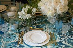 Electric blues and turquoise with whites and greens make for a lavish table setting. Greenwich CT designer florist Winston Flowers does it again