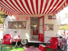 Retro red and white striped travel trailer with awning and red outdoor furniture for #vintage RV style.  #1950s #50s