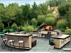 entertaining in this outdoor kitchen is a cinch! (complete with a flat screen tv… entertaining in this outdoor kitchen is a cinch! (complete with a flat screen tv that lowers into the protection of a rock cabinet during inclement weather! Outdoor Kitchen Bars, Backyard Kitchen, Outdoor Kitchen Design, Outdoor Kitchens, Outdoor Living Rooms, Outdoor Spaces, Outdoor Decor, Living Spaces, Cal Flame
