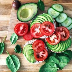Rice Cake Topped with Slices of Avocado and Tomatoes