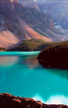 The turquoise waters of Moraine Lake nestled in the Canadian Rockies of Banff National Park, Alberta, Canada • photo: Milena Boeva
