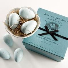 3 robin's egg soaps in footed porcelain dish