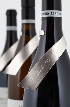 Great way to stand out from the crowd when it comes to your branding label. 'Lexi Leroux Wine Label' - Silver wine labels #branding