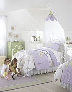 White and purple strikes again in this adorable girls shared bedroom by Pottery Barn Kids. Soft green accents work well in this feminine decor scheme. A great idea for a little girls shared bedroom. Discover more kids room decorating and organizing tips and ideas @ http://kidsroomdecorating.net