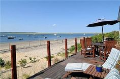 You can't get any closer to the beach than this! Check out this cottage by the sea in Orleans on Cape Cod.