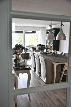 slip covered dining chairs and industrial metal pendant lighting over table - Villa Paprika