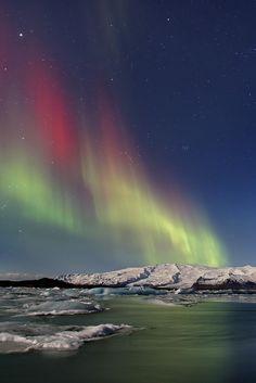 Northern Lights dance over the Glacier Lagoon . Iceland