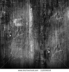 old black wood texture (for background) by caesart, via Shutterstock