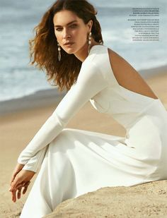 Erin Wasson strikes a pose in the alluring open-back white Clifton gown from Ralph Lauren Collection Spring '15