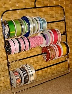 Now why didn't I think of that.  Take a multi pant hanger and use it to organize spools of ribbon.
