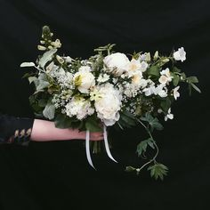 A bridal bouquet in whites and greens for loveliest Lucy. A firm favourite from 2016. Peony philadelphus nicotiana aquilegia foxgloves etc etc. making us wonder why everybody doesn't insist on marrying in May and June! #palaisweddings