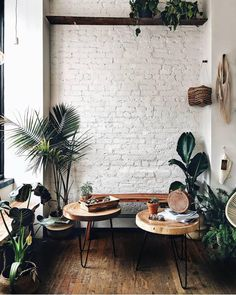 An exposed brick wall in a room doesn't always mean industrial. Moreover if we talk about the specific white brick wall, the style and design it suits will be way more than just one kind. The range is wide as . Painted Brick Walls, White Brick Walls, Exposed Brick Walls, White Bricks, White Brick Wallpaper, Faux Brick Walls, White Wood, Brick Interior, Cafe Interior Design