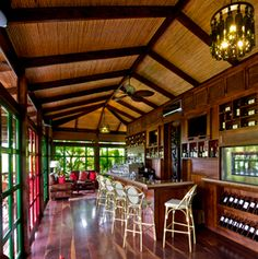 arenal volcano, rain forest, jungle, lounge, bar, interior, day, thatched roof, barstool