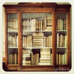 put your books on the bookshelf backwards for a less crazy look (not wise to do if you actually use the books on a regular basis lol)