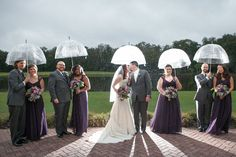 Wedding Day Bridal Party Portrait in the Rain with Clear Umbrellas | Tampa Palms Golf and Country Club | Carrie Wildes Photography
