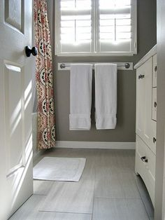 love the grey walls with white accents and a patterned shower curtain ... must do!