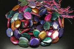 1strand  natural multy agate faceted  oval sized 20 by by 3yes